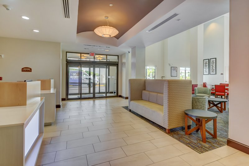 Holiday Inn Express & Suites Tampa USF Busch Gardens-Our spacious lobby is great for gathering and reconnecting!<br/>Image from Leonardo