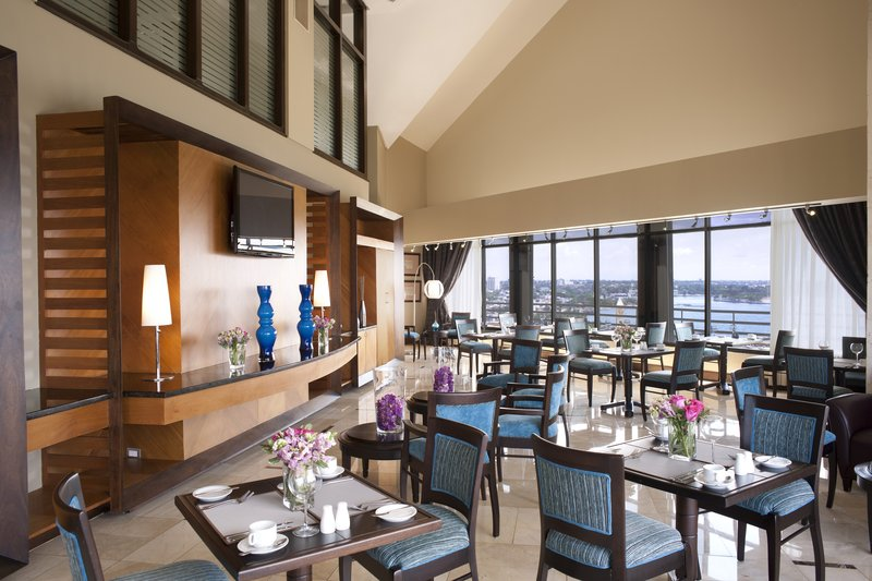 Crowne Plaza Santo Domingo-Private Club Floor Lounge - Dining and Social Area<br/>Image from Leonardo