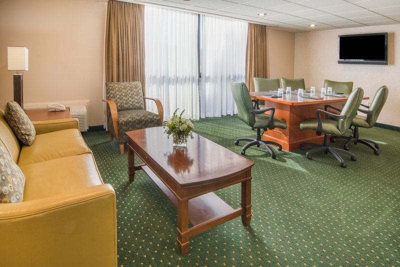 Holiday Inn Hotel & Suites Cincinnati-Eastgate (I-275e)-Hospitality Room (2 living rooms) with Board Table and Restroom<br/>Image from Leonardo