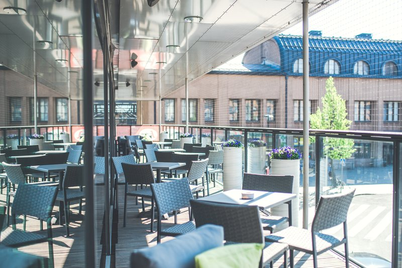 Holiday Inn Helsinki City Centre-Relax at out Terrace balcony with a refreshing drink<br/>Image from Leonardo