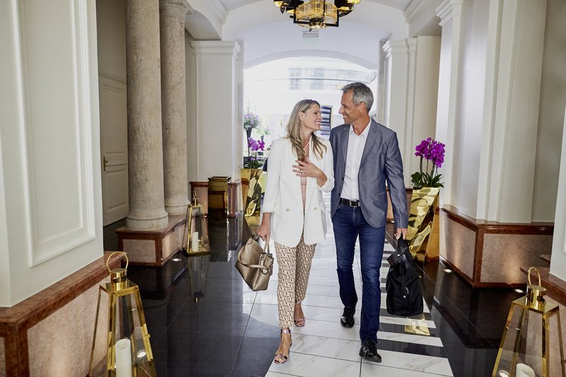 Aria Hotel Budapest by Library Hotel Collection-Couple In Hallway Entrance To Music Garden<br/>Image from Leonardo