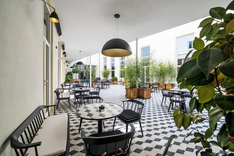 Hotel Infante Sagres-Stunning Vogue Café Patio<br/>Image from Leonardo