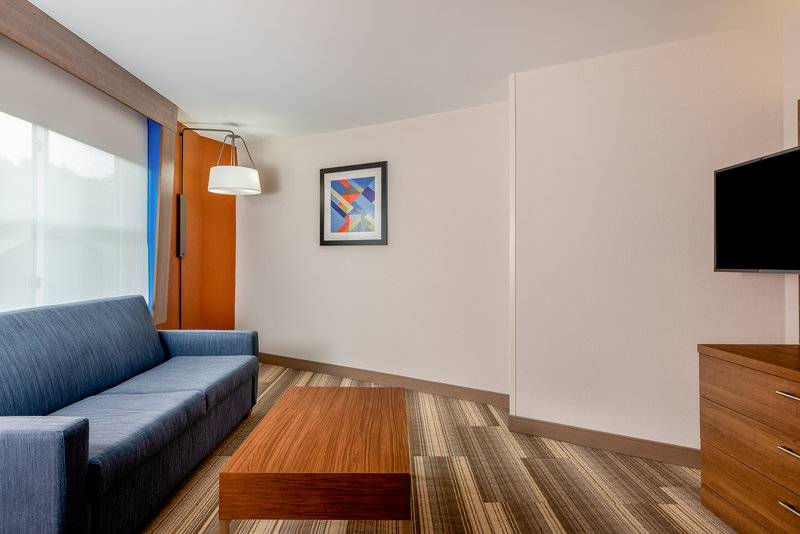 Holiday Inn Express Chapel Hill-Spread out into the separate living room area of our suite!<br/>Image from Leonardo