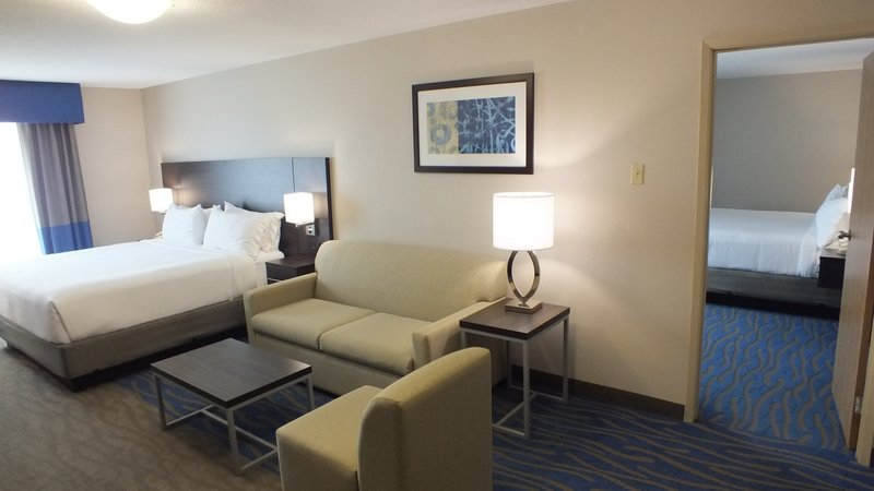 Holiday Inn Hotel & Suites Regina-Spacious Family Suites King beds in separate rooms and a sofa bed.<br/>Image from Leonardo