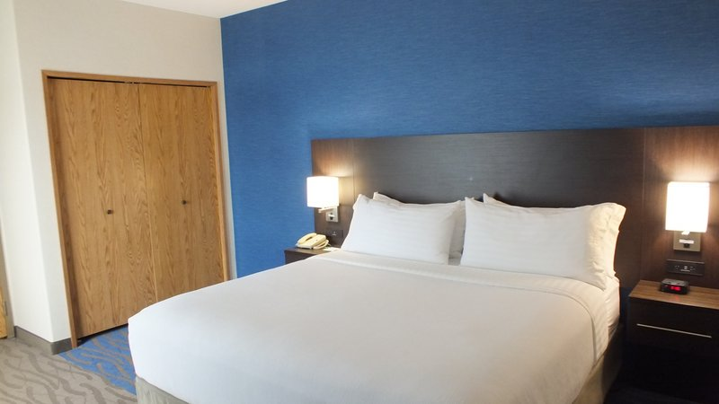 Holiday Inn Hotel & Suites Regina-Conference suite with King Bed, Sofa bed and Boardroom table.<br/>Image from Leonardo