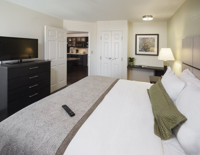 Candlewood Suites Santa Maria-Suite offering separate living and sleeping areas<br/>Image from Leonardo