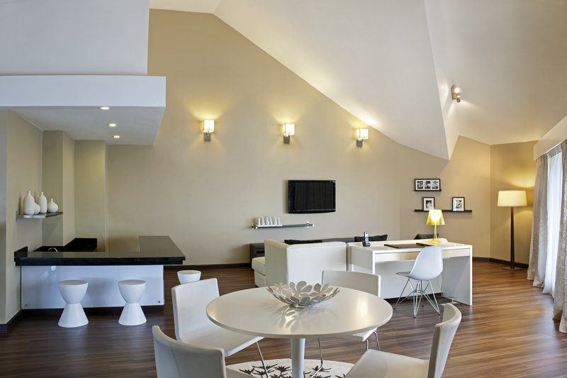 Crowne Plaza Santo Domingo-Suite Presidencial. Living area and Bar located at second level.<br/>Image from Leonardo