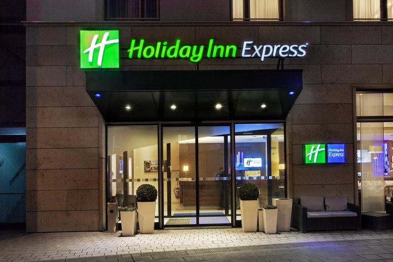 Holiday Inn Express Nuremberg City - Hauptbahnhof-The welcoming hotel entrance lit up at night. <br/>Image from Leonardo
