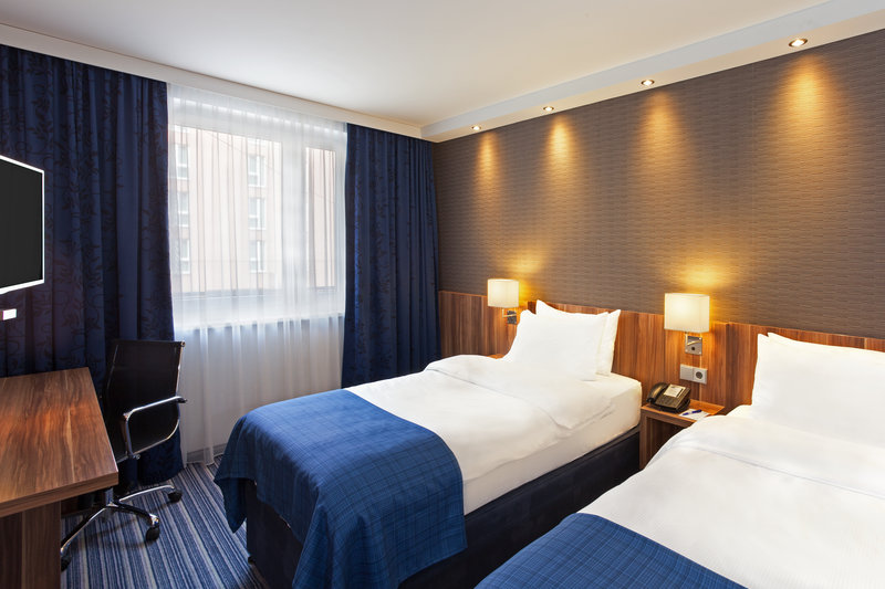 Holiday Inn Express Nuremberg City - Hauptbahnhof-Holiday Inn Express bedroom, where guests can work or relax.<br/>Image from Leonardo