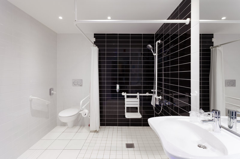 Holiday Inn Express Nuremberg City - Hauptbahnhof-Thoughtfully designed accessible bathroom with sparkling tiles.<br/>Image from Leonardo