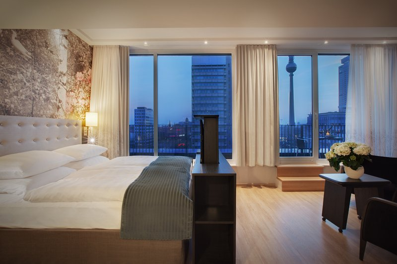Holiday Inn Berlin Centre Alexanderplatz-An elegant Executive room with balcony views of the TV Tower.<br/>Image from Leonardo