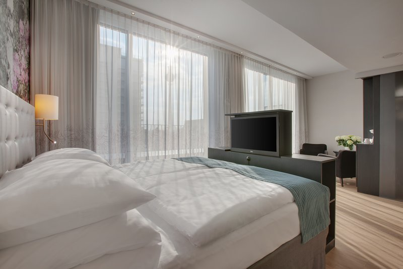 Holiday Inn Berlin Centre Alexanderplatz-An Executive room with a comfortable sitting area and city views.<br/>Image from Leonardo
