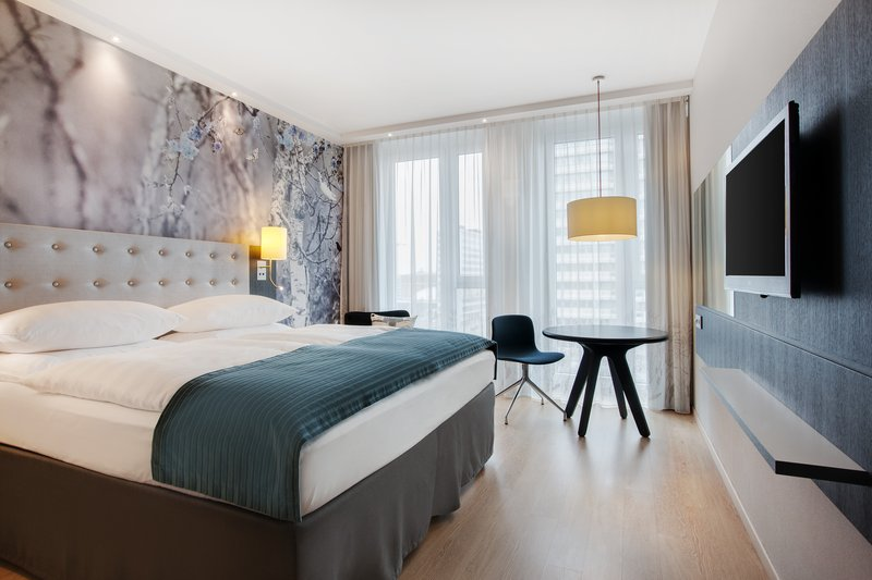 Holiday Inn Berlin Centre Alexanderplatz-A light-filled room with a queen-size bed and flat-screen TV.<br/>Image from Leonardo
