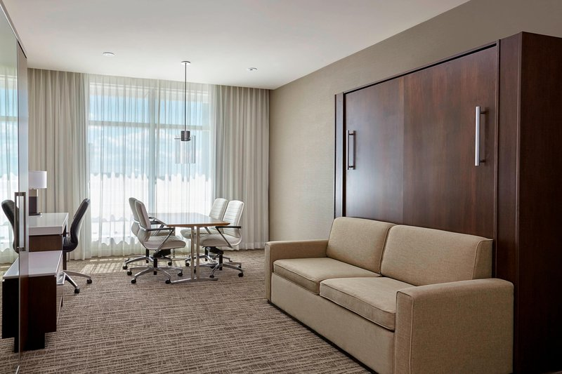 Calgary Airport Marriott In-Terminal Hotel-Hospitality Guest Room - Living Area<br/>Image from Leonardo