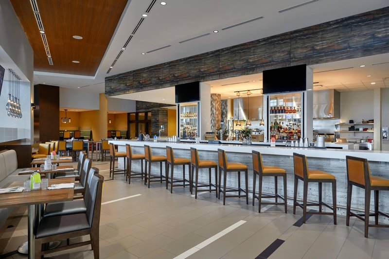 Delta Hotel Calgary Airport In-Terminal-YAKIMA Social Kitchen + Bar - Seating<br/>Image from Leonardo