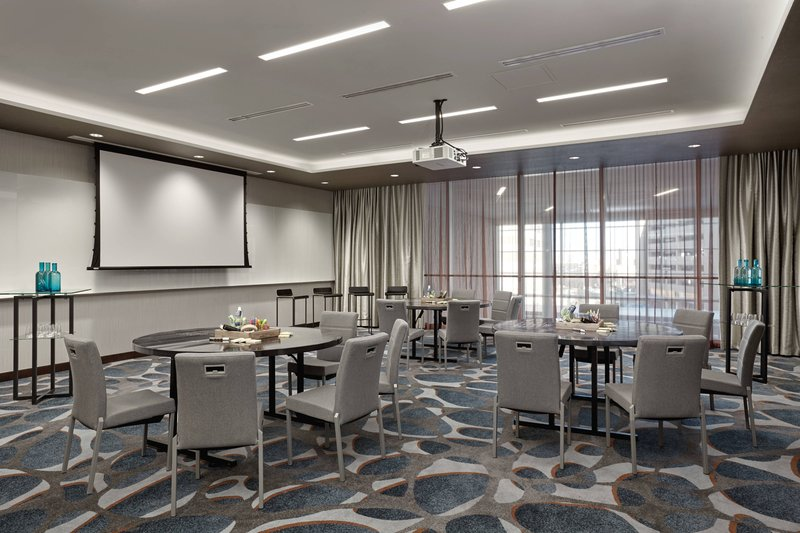 Delta Hotel Calgary Airport In-Terminal-Stratus Meeting Room - Rounds Setup<br/>Image from Leonardo