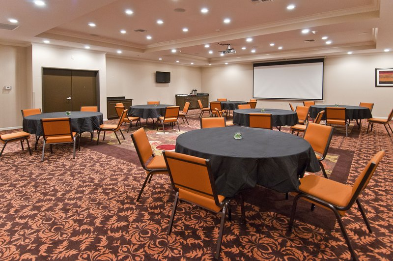 Holiday Inn Hotel & Suites Lake Charles South-Holiday Inn Lake Charles Meeting Room - Set with Round Tables<br/>Image from Leonardo