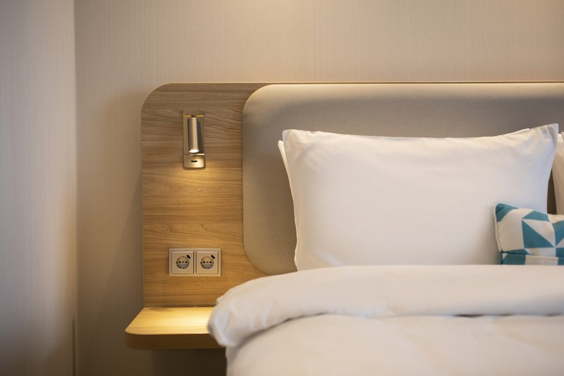 Holiday Inn Express Hamburg - City Hauptbahnhof-Next Generation bedrooms have USB ports and controlled lighting.<br/>Image from Leonardo