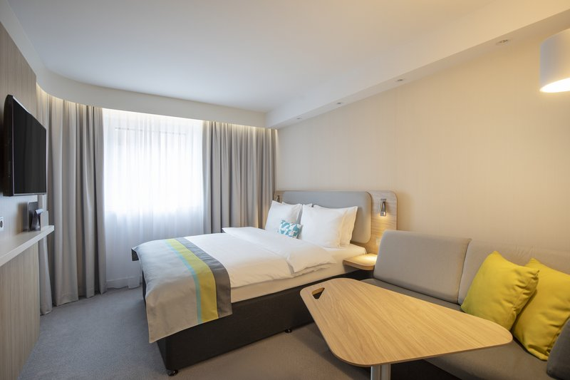 Holiday Inn Express Hamburg - City Hauptbahnhof-Comfortable room with a sofa and a desk for working or relaxing. <br/>Image from Leonardo