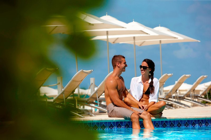 Marriott Grand Cayman-Couple at the pool<br/>Image from Leonardo