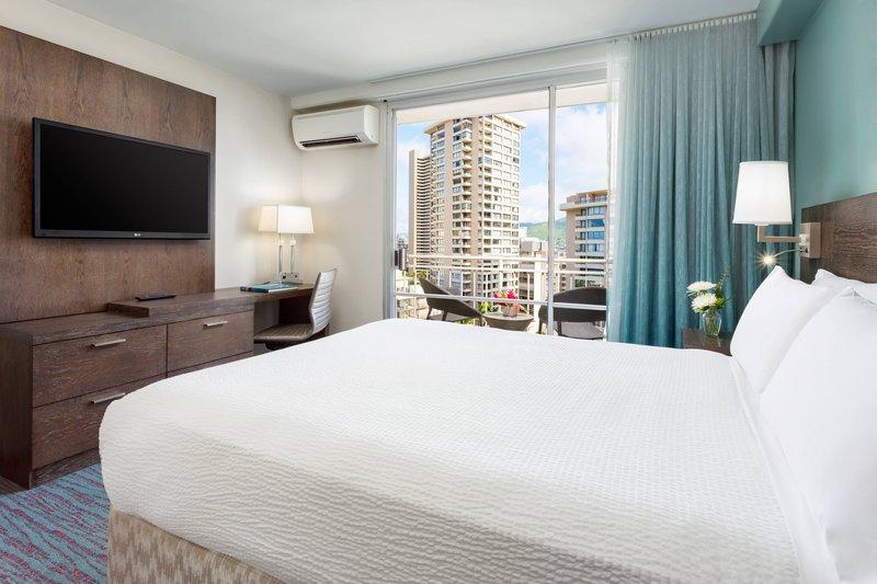Courtyard by Marriott Waikiki-Queen Guest Room Sleeping Area<br/>Image from Leonardo