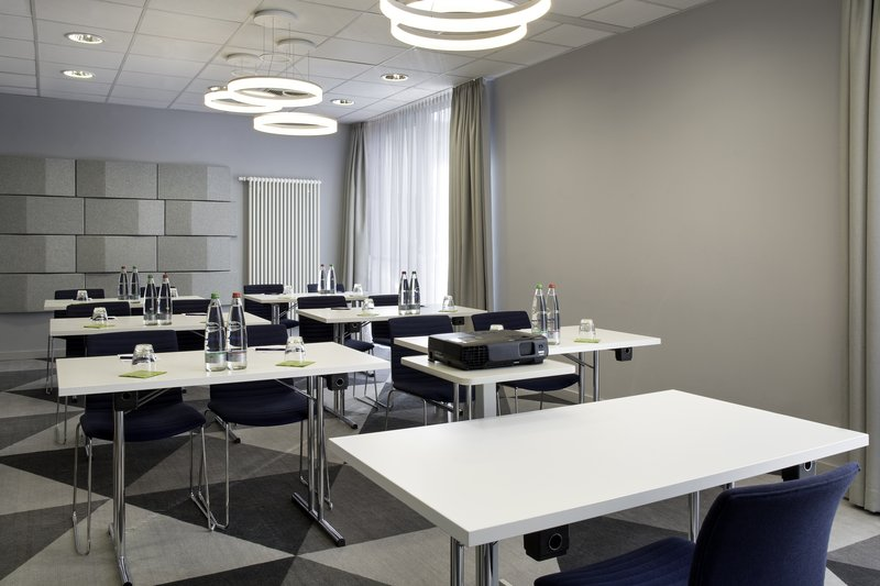 Holiday Inn Express Stuttgart Airport-Meeting room in smart monochrome tones, holding up to 20 people.<br/>Image from Leonardo