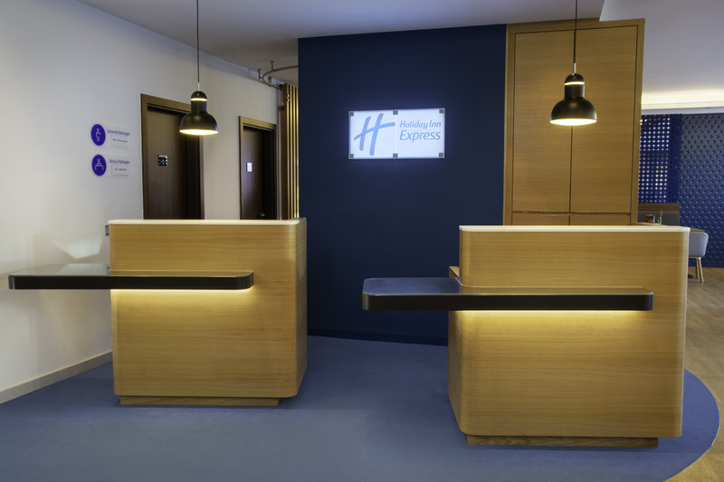 Holiday Inn Express Stuttgart Airport-Reception desks in the lobby for a warm welcome for all guests.<br/>Image from Leonardo