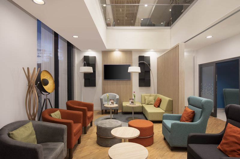 Holiday Inn Express Hamburg - City Hauptbahnhof- Inviting soft seating in a lounge area of the hotel lobby. <br/>Image from Leonardo