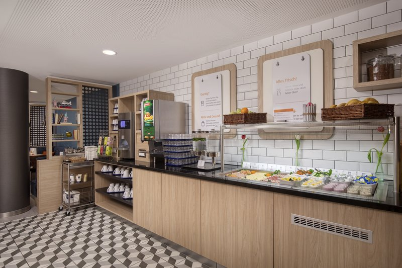 Holiday Inn Express Hamburg - City Hauptbahnhof-Inclusive Express Start Breakfast with cheeses, meats and yoghurt.<br/>Image from Leonardo