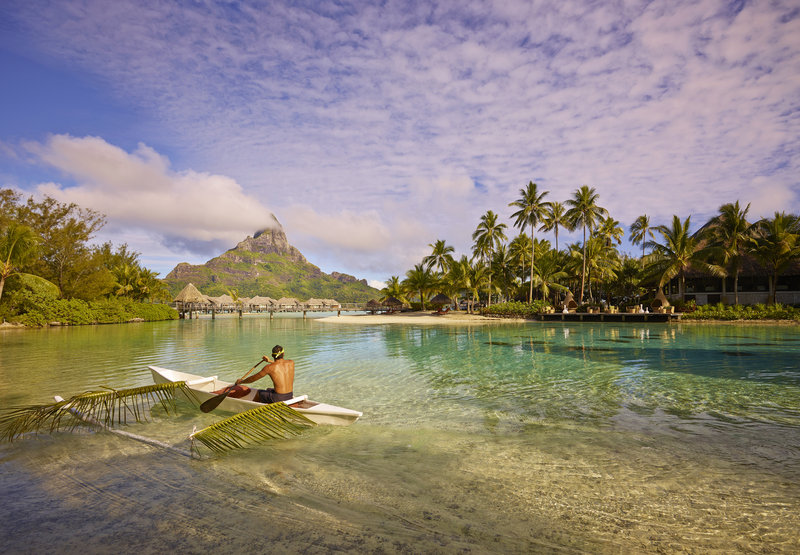 Intercontinental Bora Bora Resort-Traditional outrigger canoe in the coral garden<br/>Image from Leonardo