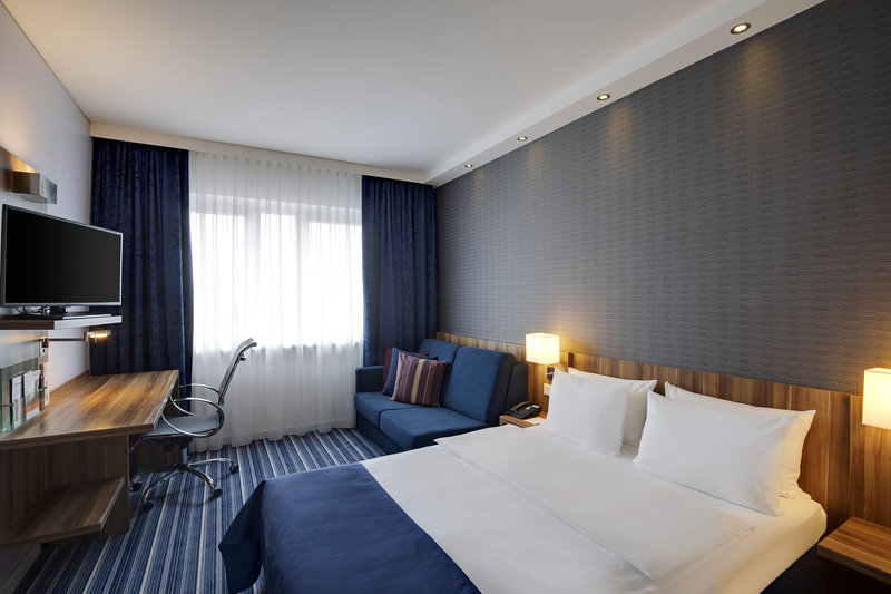 Holiday Inn Express Bremen Airport-A spacious room with a double bed, sofa and executive desk.<br/>Image from Leonardo