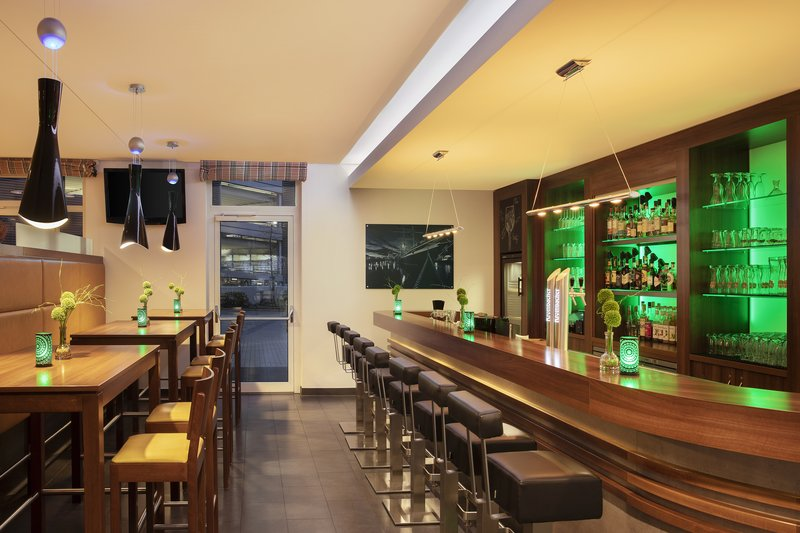 Holiday Inn Express Bremen Airport-A welcoming bar with high stools, ideal for evening cocktails.<br/>Image from Leonardo