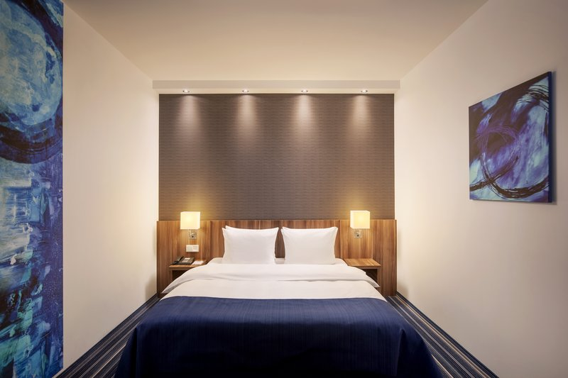 Holiday Inn Express Bremen Airport-A standard room with a comfy double bed and inclusive Wi-Fi.<br/>Image from Leonardo