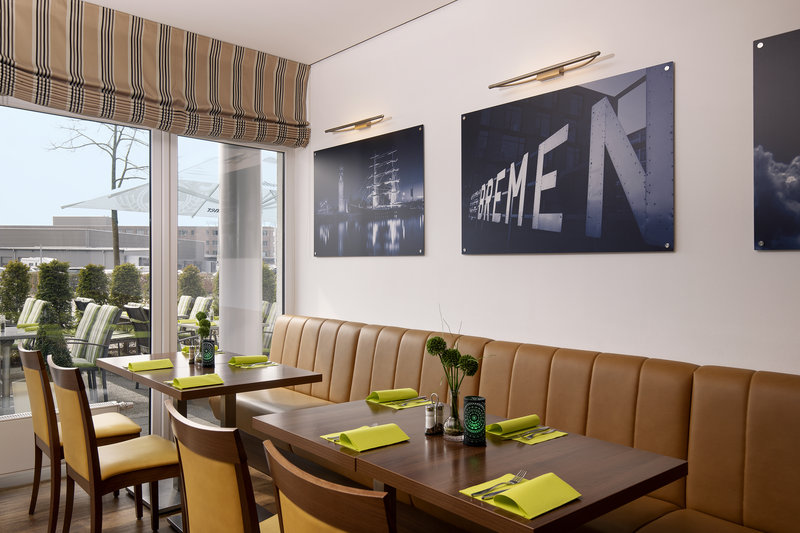 Holiday Inn Express Bremen Airport-A bright and airy breakfast room looking onto the patio.<br/>Image from Leonardo