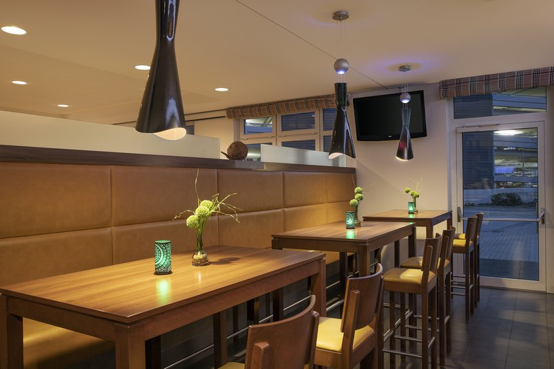 Holiday Inn Express Bremen Airport-Banquette seating and high tables in the inviting on-site bar.<br/>Image from Leonardo