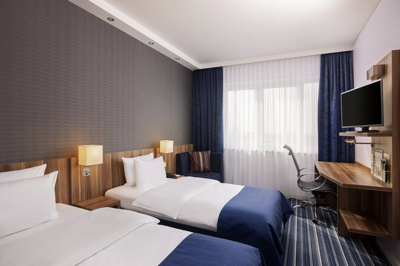 Holiday Inn Express Bremen Airport-Twin beds in a comfortable double room with a large work desk.<br/>Image from Leonardo