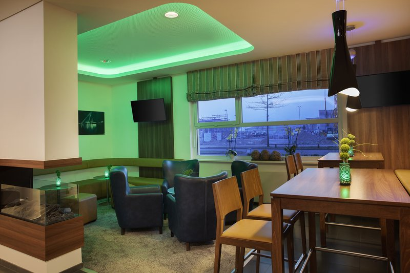 Holiday Inn Express Bremen Airport-Comfy armchairs in the cosy bar, ideal for drinks with friends.<br/>Image from Leonardo