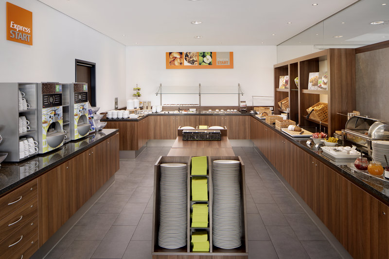 Holiday Inn Express Bremen Airport-Express Start Breakfast bar with cereals, meats and fresh coffee.<br/>Image from Leonardo