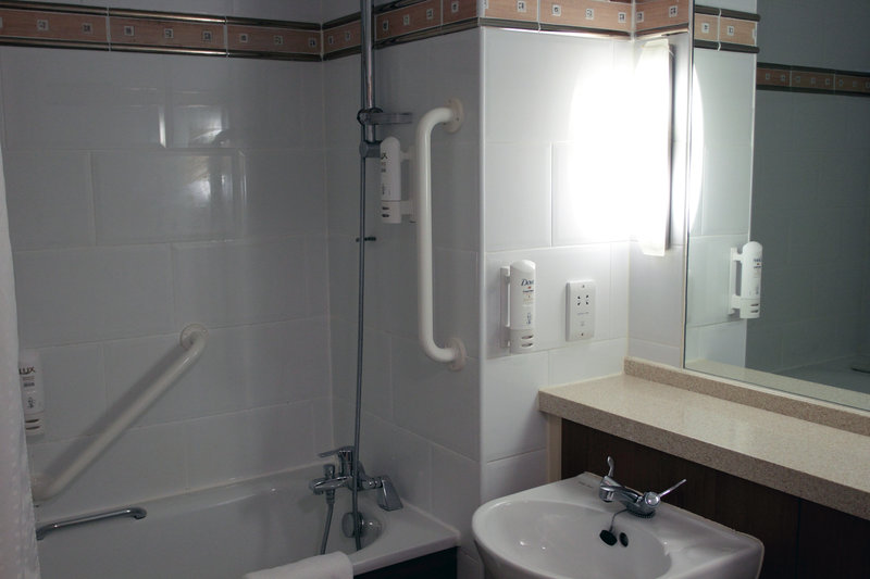 Holiday Inn A55 Chester West-Accessible room bathroom with shower over bath<br/>Image from Leonardo
