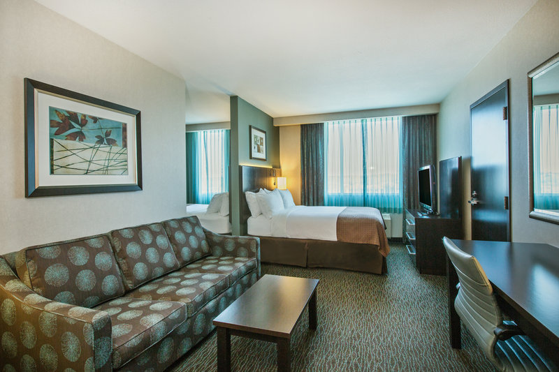 Holiday Inn Saskatoon Downtown-A divider wall gives you great separation between the queen beds.<br/>Image from Leonardo