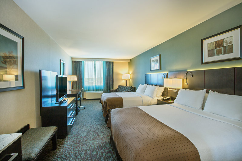 Holiday Inn Saskatoon Downtown-Two queen beds with sleeper chair.  Sleep up to (5) guests.<br/>Image from Leonardo