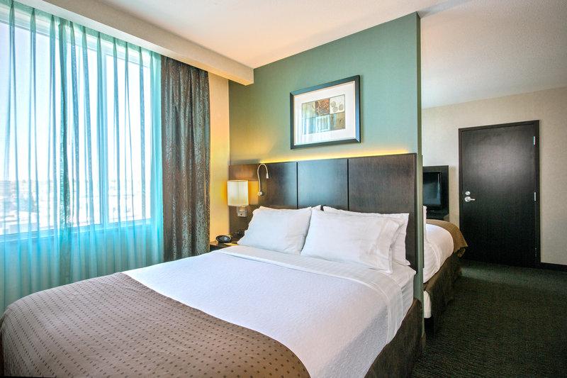 Holiday Inn Saskatoon Downtown-Enjoy amenities like triple sheeted, white cotton bedding.<br/>Image from Leonardo