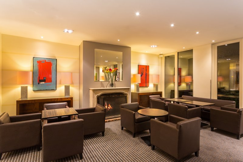 Holiday Inn Cambridge-Kick back in front of our cheerful Lobby Fireplace<br/>Image from Leonardo