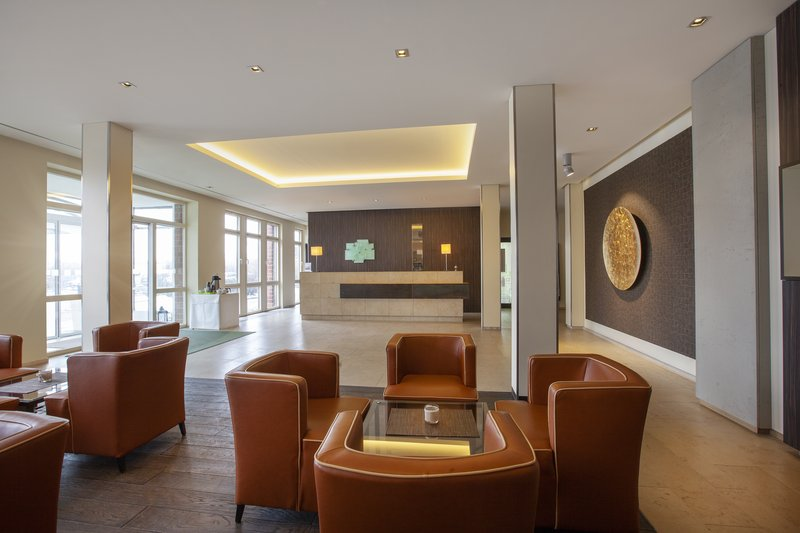 Holiday Inn Leipzig - Gunthersdorf-Comfortable armchairs in the lobby, flooded with natural light.<br/>Image from Leonardo