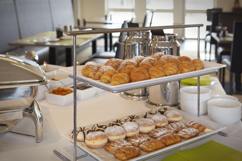 Holiday Inn Leipzig - Gunthersdorf-A tray of fresh pastries on the breakfast buffet.<br/>Image from Leonardo