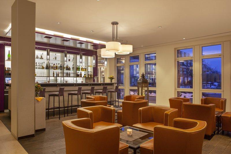 Holiday Inn Leipzig - Gunthersdorf-Designer seating in a colourful Holiday Inn bar in Leipzig.<br/>Image from Leonardo