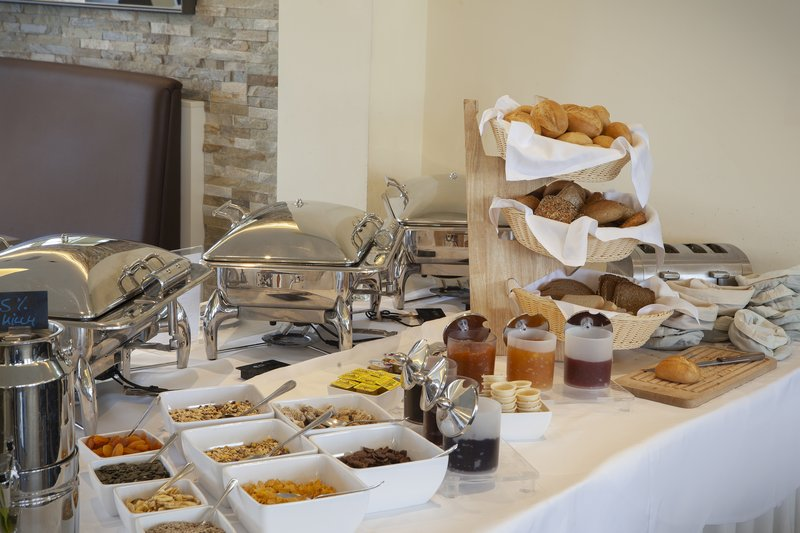 Holiday Inn Leipzig - Gunthersdorf-An array of cereals, dried fruit and crusty bread for breakfast.<br/>Image from Leonardo
