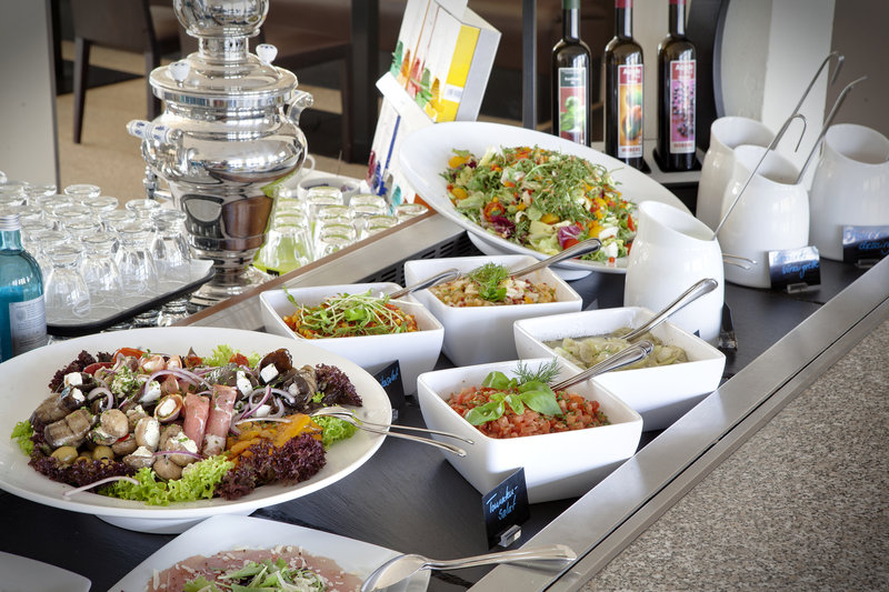 Holiday Inn Leipzig - Gunthersdorf-Delicious, fresh salads and meats served in the hotel restaurant.<br/>Image from Leonardo