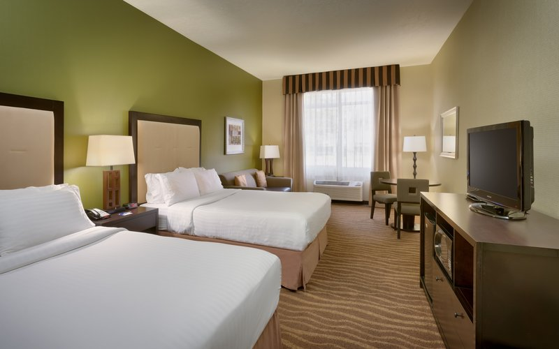 Holiday Inn Express & suites American Fork - North Provo-Spread out in a double queen and sofa room in American Fork.<br/>Image from Leonardo