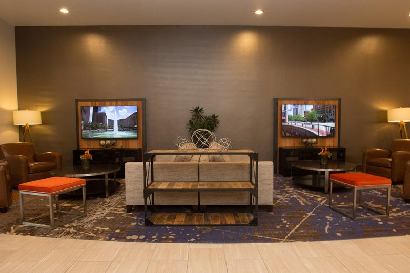 Holiday Inn Dayton/Fairborn I-675-Working on your lap top while enjoying our open concept seating.<br/>Image from Leonardo